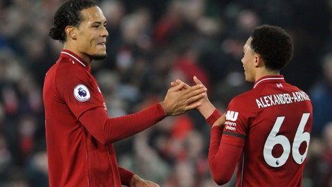 <p>               Liverpool's Virgil van Dijk, left, celebrates with Liverpool's Trent Alexander-Arnold at the end of the English Premier League soccer match between Liverpool and Watford at Anfield stadium in Liverpool, England, Wednesday, Feb. 27, 2019. (AP Photo/Rui Vieira)             </p>