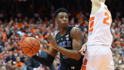 SYRACUSE, NY - FEBRUARY 23:  RJ Barrett #5 of the Duke Blue Devils looks to pass the ball around Marek Dolezaj #21 of the Syracuse Orange during the first half at the Carrier Dome on February 23, 2019 in Syracuse, New York. (Photo by Rich Barnes/Getty Images)