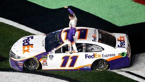 DAYTONA BEACH, FL - FEBRUARY 17:  Denny Hamlin, driver of the #11 FedEx Express Toyota, celebrates winning the Monster Energy NASCAR Cup Series 61st Annual Daytona 500 at Daytona International Speedway on February 17, 2019 in Daytona Beach, Florida.  (Photo by Brian Lawdermilk/Getty Images)