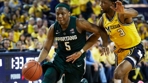 Feb 24, 2019; Ann Arbor, MI, USA; Michigan State Spartans guard Cassius Winston (5) dribbles defended by Michigan Wolverines guard Zavier Simpson (3) in the second half at Crisler Center. Mandatory Credit: Rick Osentoski-USA TODAY Sports