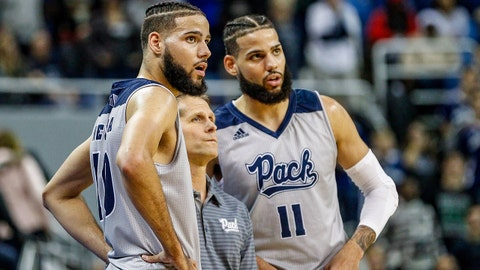 RENO, NV - DECEMBER 15: Cody Martin #11 of the Nevada Wolf Pack and brother Caleb Martin #10 of the Nevada Wolf Pack talk to head coach Eric Musselman of the Nevada Wolf Pack during the game between the Nevada Wolf Pack and the South Dakota State Jackrabbits at Lawlor Events Center on December 15, 2018 in Reno, Nevada. (Photo by Jonathan Devich/Getty Images)