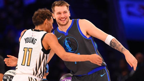 Feb 16, 2019; Charlotte, NC, USA; Atlanta Hawks guard Trae Young greets Dallas Mavericks guard Luka Doncic in the Skills Challenge during the NBA All-Star Saturday Night at Spectrum Center. Mandatory Credit:  Bob Donnan-USA TODAY Sports