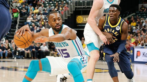 Feb 11, 2019; Indianapolis, IN, USA; Charlotte Hornets guard Kemba Walker (15) handles the ball while guarded by Indiana Pacers guard Darren Collison (2) during the first quarter at Bankers Life Fieldhouse. Mandatory Credit: Brian Spurlock-USA TODAY Sports