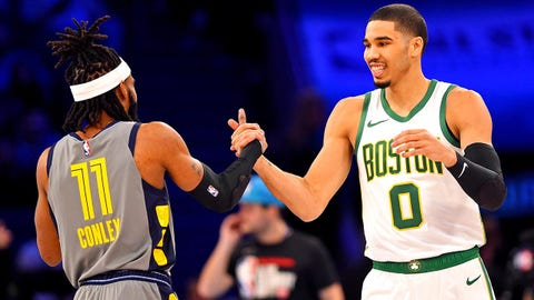 Feb 16, 2019; Charlotte, NC, USA; Memphis Grizzlies guard Mike Conley and Boston Celtics forward Jayson Tatum greet each other in the Skills Challenge during the NBA All-Star Saturday Night at Spectrum Center. Mandatory Credit:  Bob Donnan-USA TODAY Sports