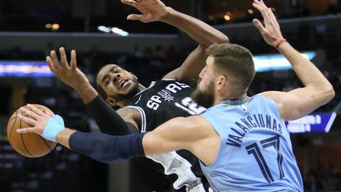 Feb 12, 2019; Memphis, TN, USA; San Antonio Spurs forward LaMarcus Aldridge (12) is fouled by Memphis Grizzlies center Jonas Valanciunas (17) during the second half at FedExForum. Spurs won 108-107. Mandatory Credit: Nelson Chenault-USA TODAY Sports