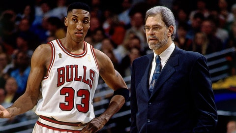 CHICAGO - JUNE 1:  Scottie Pippen #33 of the Chicago Bulls talks with head coach Phil Jackson Bulls in Game One of the 1997 NBA Finals against the Utah Jazz at the United Center on June 1, 1997 in Chicago, Illinois.  The Bulls won 84-82.  NOTE TO USER: User expressly acknowledges that, by downloading and or using this photograph, User is consenting to the terms and conditions of the Getty Images License agreement. Mandatory Copyright Notice: Copyright 1997 NBAE (Photo by Nathaniel S. Butler/NBAE via Getty Images)