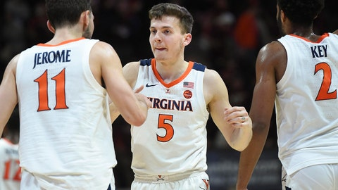 Feb 18, 2019; Blacksburg, VA, USA; Virginia Cavaliers guard Kyle Guy (5) celebrates with Ty Jerome (11) and guard Braxton Key (2) following the victory against the Virginia Tech Hokies at Cassell Coliseum. Mandatory Credit: Michael Shroyer-USA TODAY Sports