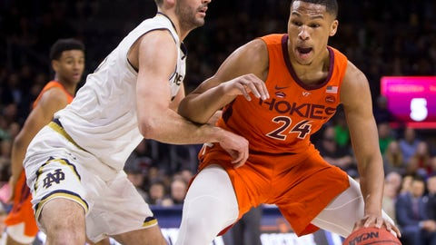 <p>               Virginia Tech's Kerry Blackshear Jr., right, is defended by Notre Dame's John Mooney during the first half of an NCAA college basketball game Saturday, Feb. 23, 2019, in South Bend, Ind. (AP Photo/Robert Franklin)             </p>