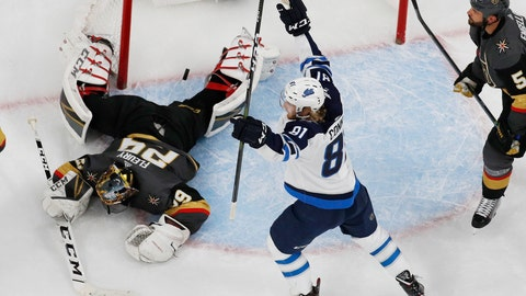 <p>               Winnipeg Jets left wing Kyle Connor (81) celebrates after Winnipeg Jets right wing Patrik Laine scored against Vegas Golden Knights goaltender Marc-Andre Fleury (29) during the second period of an NHL hockey game Friday, Feb. 22, 2019, in Las Vegas. (AP Photo/John Locher)             </p>
