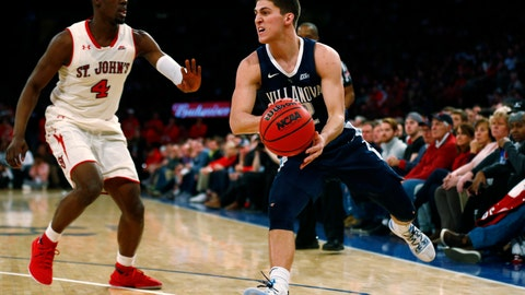 <p>               Villanova guard Collin Gillespie passes around St. John's guard Greg Williams Jr. (4) during the first half of an NCAA college basketball game Sunday, Feb. 17, 2019, in New York. (AP Photo/Adam Hunger)             </p>