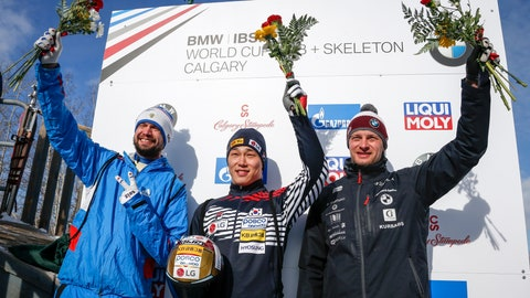 <p>               South Korea's Sungbin Yun, center, celebrates his victory with second-place finisher Russia's Alexander Tretiakov, left, and third-place finisher Latvia's Tomass Dukurs in the men's World Cup skeleton event in Calgary, Alberta, Sunday, Feb. 24, 2019. (Jeff McIntosh/The Canadian Press via AP)             </p>