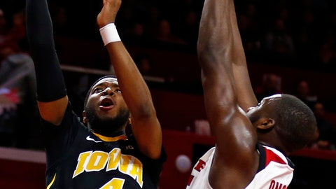 <p>               Iowa guard Isaiah Moss (4) shoots over Rutgers forward Eugene Omoruyi (5) during the first half of an NCAA college basketball game Saturday, Feb. 16, 2019, in Piscataway, N.J. (AP Photo/Adam Hunger)             </p>