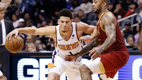 <p>               Phoenix Suns guard Devin Booker drives against the Houston Rockets forward PJ Tucker, right, during the second half of an NBA basketball game,, Monday, Feb. 4, 2019, in Phoenix. (AP Photo/Matt York)             </p>