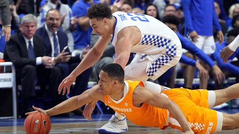 <p>               Kentucky's Reid Travis, top, and Tennessee's Grant Williams chase down a loose ball during the first half of an NCAA college basketball game in Lexington, Ky., Saturday, Feb. 16, 2019. (AP Photo/James Crisp)             </p>