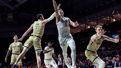 <p>               Miami guard Dejan Vasiljevic (1) gets inside in the first half of an NCAA college basketball game against Georgia Tech  in Coral Gables, Fla., on Saturday, Feb. 23, 2019. (Al Diaz/Miami Herald via AP)             </p>