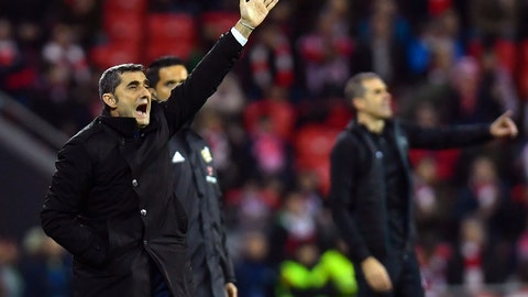 <p>               FC Barcelona's head manager Ernesto Valverder, left, and Athletic Bilbao's head manager Gaizka Garitano, give instructions during the Spanish La Liga soccer match between Athletic Bilbao and FC Barcelona at San Mames stadium, in Bilbao, northern Spain, Sunday, Feb. 10, 2019. FC Barcelona tied he match 0-0.(AP Photo/Alvaro Barrientos)             </p>