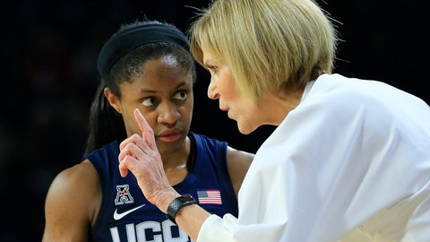 <p>               Connecticut associate head coach Chris Dailey, right, gives orders to Crystal Dangerfield during the second half of an NCAA college basketball game against Tulsa in Tulsa, Okla., on Sunday, Feb. 24, 2019. Head coach Geno Auriemma missed the game due to illness. (AP Photo/Dave Crenshaw)             </p>
