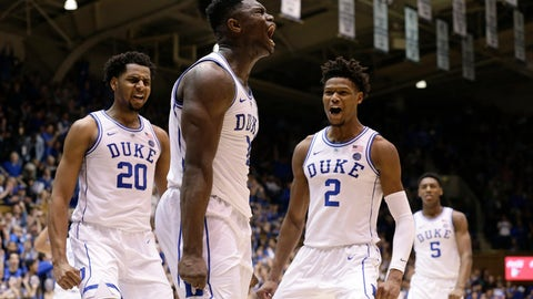 <p>               Duke's Zion Williamson, center, reacts with Marques Bolden (20), Cam Reddish (2) and RJ Barrett (5) following a play against St. John's during the second half of an NCAA college basketball game in Durham, N.C., Saturday, Feb. 2, 2019. Duke won 91-61. (AP Photo/Gerry Broome)             </p>