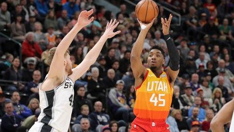 <p>               Utah Jazz guard Donovan Mitchell (45) shoots past the arms of San Antonio Spurs forward Davis Bertans (42) during the first quarter of an NBA basketball game, Saturday, Feb. 9, 2019, in Salt Lake City. (AP Photo/Chris Nicoll)             </p>