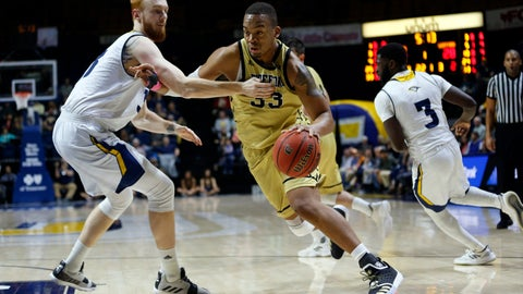 <p>               Wofford forward Cameron Jackson (33) drives as Chattanooga center Thomas Smallwood, left, defends during the first half of an NCAA college basketball game Thursday, Feb. 28, 2019, in Chattanooga, Tenn. (AP photo/Wade Payne)             </p>