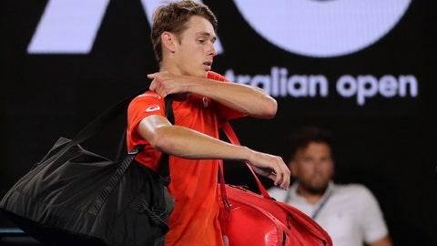 <p>               Australia's Alex de Minaur leaves Rod Laver Arena after losing his third round match against Spain's Rafael Nadal at the Australian Open tennis championships in Melbourne, Australia, Friday, Jan. 18, 2019. (AP Photo/Kin Cheung)             </p>