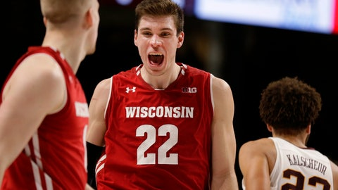 <p>               Wisconsin forward Ethan Happ (22) celebrates with teammate Brevin Pritzl (1) as Minnesota guard Gabe Kalscheur (22) walks off after an NCAA college basketball game Wednesday, Feb. 6, 2019, in Minneapolis. Wisconsin defeated Minnesota 56-51. (AP Photo/Andy Clayton-King)             </p>