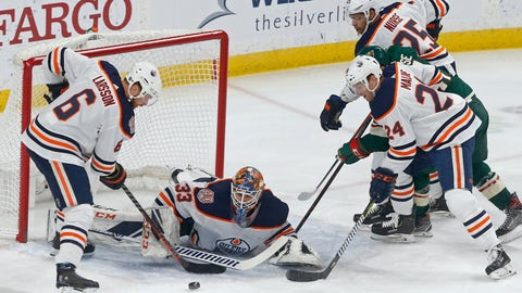 <p>               Edmonton Oilers' Adam Larsson, left, of Sweden, and Brad Malone, right, assist goalie Cam Talbot as Minnesota Wild's Zach Parise, in middle at right, can't reach the rebound during the first period of an NHL hockey game Thursday, Feb. 7, 2019 in St. Paul, Minn. (AP Photo/Jim Mone)             </p>