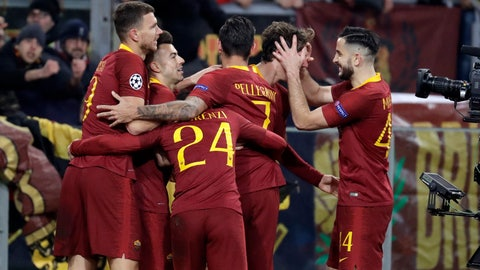 <p>               Roma players celebrate the second goal of their team during a Champions League round of 16 first leg soccer match between Roma and Porto, at Rome's Olympic Stadium, Tuesday, Feb. 12, 2019. (AP Photo/Andrew Medichini)             </p>