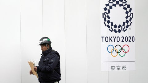 <p>               In this Feb. 12, 2019, photo, a worker walks past one of construction sites for the Tokyo 2020 Olympics in Tokyo. The price of the opening and closing ceremony for the Tokyo Olympics has risen about 40 percent according to numbers released by the organizing committee. (AP Photo/Eugene Hoshiko)             </p>