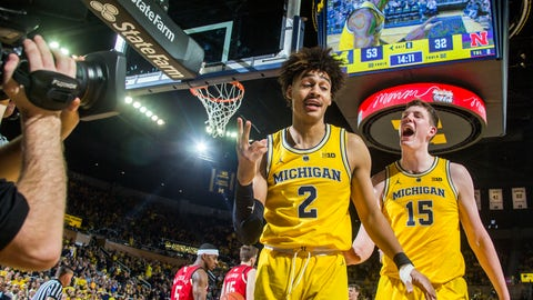 <p>               Michigan guard Jordan Poole (2) celebrates a slam dunk with center Jon Teske (15), in the second half of an NCAA college basketball game against Nebraska at Crisler Center in Ann Arbor, Mich., Thursday, Feb. 28, 2019. Michigan won 82-53. (AP Photo/Tony Ding)             </p>