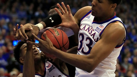 <p>               Kansas forward David McCormack (33) rebounds with guard Ochai Agbaji (30) during the second half of an NCAA college basketball game in Lawrence, Kan., Saturday, Feb. 2, 2019. Texas Tech center Norense Odiase, back, is boxed out on the play. Kansas defeated Texas Tech 79-63. (AP Photo/Orlin Wagner)             </p>