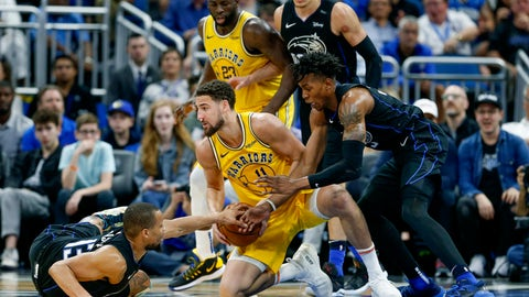 <p>               Orlando Magic guard Isaiah Briscoe (13) and forward Wesley Iwundu (25) fight for the loose ball with Golden State Warriors guard Klay Thompson (11) as Magic forward Aaron Gordon (00) and Warriors forward Draymond Green (23) look on during the second half of an NBA basketball game in Orlando, Fla., on Thursday, Feb. 28, 2019. (AP Photo/Reinhold Matay)             </p>
