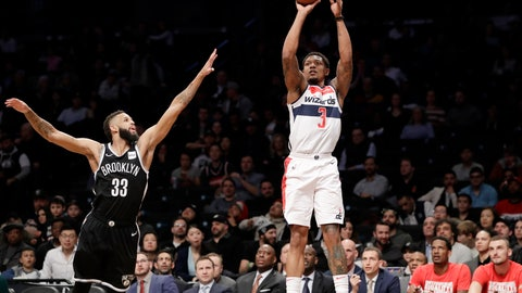 <p>               Brooklyn Nets guard Allen Crabbe (33) defends as Washington Wizards guard Bradley Beal (3) shoots a three-pointer during the first half of an NBA basketball game, Wednesday, Feb. 27, 2019, in New York. (AP Photo/Kathy Willens)             </p>