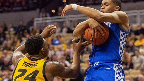<p>               Missouri's Kevin Puryear, left, defends as Kentucky's Keldon Johnson, right, tries to pull in a rebound during the first half of an NCAA college basketball game Tuesday, Feb. 19, 2019, in Columbia, Mo. (AP Photo/L.G. Patterson)             </p>