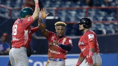 <p>               Jilton Calderon, center, Jonathan Galvez, left, and Allen Cordoba, right, of Panama's Los Toros de Herrera, celebrate on home plate after scoring runs against Puerto Rico's Cangrejeros de Santurce during the Caribbean Series baseball tournament at Rod Carew stadium in Panama City, Wednesday, Feb. 6, 2019. (AP Photo/Arnulfo Franco)             </p>