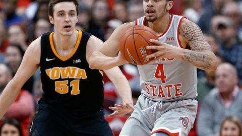 <p>               Ohio State guard Duane Washington, right, passes the ball away from Iowa forward Nicholas Baer during the first half of an NCAA college basketball game in Columbus, Ohio, Tuesday, Feb. 26, 2019. (AP Photo/Paul Vernon)             </p>