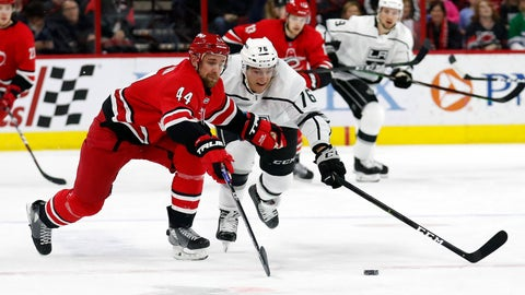 <p>               Carolina Hurricanes' Calvin de Haan (44) and Los Angeles Kings' Jonny Brodzinski (76) go for the puck during the first period of an NHL hockey game in Raleigh, N.C., Tuesday, Feb. 26, 2019. (AP Photo/Chris Seward)             </p>
