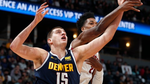 <p>               Denver Nuggets center Nikola Jokic, left, fights for control of a rebound with Miami Heat center Hassan Whiteside, right, in the first half of an NBA basketball game Monday, Feb. 11, 2019, in Denver. (AP Photo/David Zalubowski)             </p>
