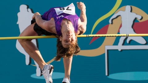 <p>               FILE - In this file photo dated Thursday, July 21, 2016,  Russian high jumper Ivan Ukhov during the Russian Athletics Cup, at Zhukovsky, outside Moscow, Russia.  Olympic high jump champion Ivan Ukhov is among 12 Russian track and field athletes found guilty of taking part in state-backed doping, according to an announcement Friday Feb. 1, 2019, by The Court of Arbitration for Sport. (AP Photo/Alexander Zemlianichenko, FILE)             </p>