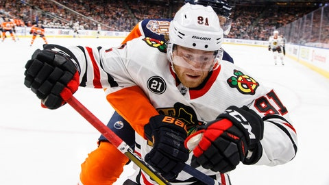 <p>               Chicago Blackhawks' Drake Caggiula (91) battles in the corner with Edmonton Oilers' Kris Russell during the first period of an NHL hockey game Tuesday, Feb. 5, 2019, in Edmonton, Alberta. (Jason Franson/The Canadian Press via AP)             </p>