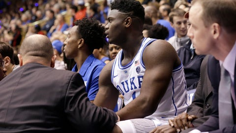 <p>               Duke's Zion Williamson (1) is attended to on the bench following an injury during the first half of an NCAA college basketball game against North Carolina in Durham, N.C., Wednesday, Feb. 20, 2019. (AP Photo/Gerry Broome)             </p>
