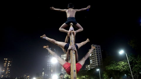 <p>               In this Feb. 6, 2019, photo, players perform on a mallakhamb pole at the Shree Samartha Vyayam Mandir at Shivaji Park in Mumbai, India. The word mallakhamb comes from malla, meaning wrestler, and khamb, or pole, and is a traditional training exercise for wrestlers in India. After centuries of being practiced in isolation in the subcontinent, mallakhamb is set to have its first international championship in Mumbai on Feb. 16 and 17. (AP Photo/Rafiq Maqbool)             </p>