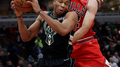 <p>               Milwaukee Bucks forward Giannis Antetokounmpo, left, rebounds a ball against Chicago Bulls center Robin Lopez during the first half of an NBA basketball game Monday, Feb. 11, 2019, in Chicago. (AP Photo/Nam Y. Huh)             </p>