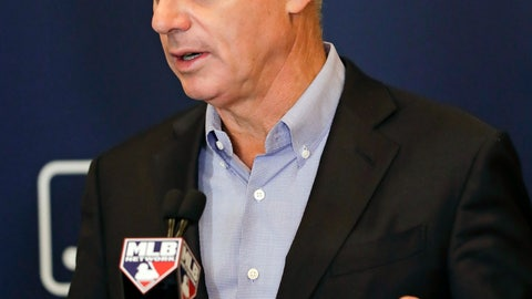 "<p>               FILE - In this Feb. 8, 2019, file photo, Rob Manfred, commissioner of Major League Baseball, speaks during a news conference at owners meetings in Orlando, Fla. Players' union head Tony Clark criticized baseball Commissioner Rob Manfred for blaming players' demands for the slow free agent market and said an increasing number of teams make little effort to ""justify the price of a ticket."" (AP Photo/John Raoux, File)             </p>"