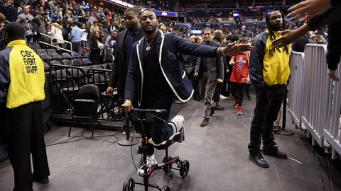 <p>               Washington Wizards guard John Wall greets fans after the team's NBA basketball game against the Cleveland Cavaliers, Friday, Feb. 8, 2019, in Washington. The Wizards won 119-106. (AP Photo/Nick Wass)             </p>
