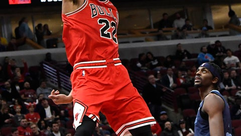 <p>               Chicago Bulls forward Otto Porter Jr. (22) dunks the ball as Memphis Grizzlies forward Justin Holiday (7) stands nearby during the second half of an NBA basketball game, Wednesday, Feb. 13, 2019, in Chicago. The Bulls won 122-110. (AP Photo/David Banks)             </p>