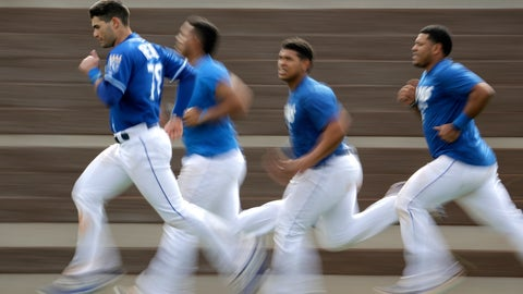 <p>               Kansas City Royals' Jordan Romano, left, leads teammates as they run sprints during baseball spring training Friday, Feb. 15, 2019, in Surprise, Ariz. (AP Photo/Charlie Riedel)             </p>