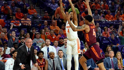 <p>               Clemson's Shelton Mitchell (4) shoots a 3-pointer over Virginia Tech's Nickeil Alexander-Walker during the first half of an NCAA college basketball game Saturday, Feb. 9, 2019, in Clemson, S.C.. (AP Photo/Richard Shiro)             </p>
