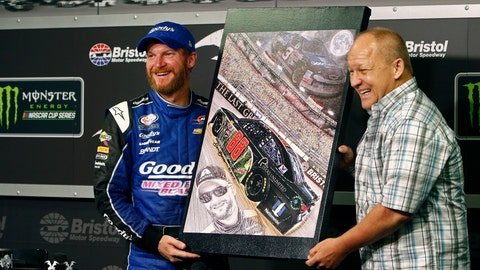 <p>               FILE - In this Aug. 17, 2017, file photo, NASCAR driver Dale Earnhardt Jr., left, stands with artist Sam Bass as he's presented with an original painting during a press conference at Bristol Motor Speedway in Bristol, Tenn. Bass, NASCAR's first officially licensed artist, has died following a battle with kidney problems. He was 57.   (AP Photo/Wade Payne, File)             </p>