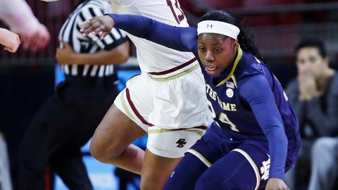<p>               Notre Dame guard Arike Ogunbowale, right, dribbles around Boston College forward Taylor Soule (13) during the first half of an NCAA college basketball game in Boston, Wednesday, Feb. 13, 2019. (AP Photo/Charles Krupa)             </p>